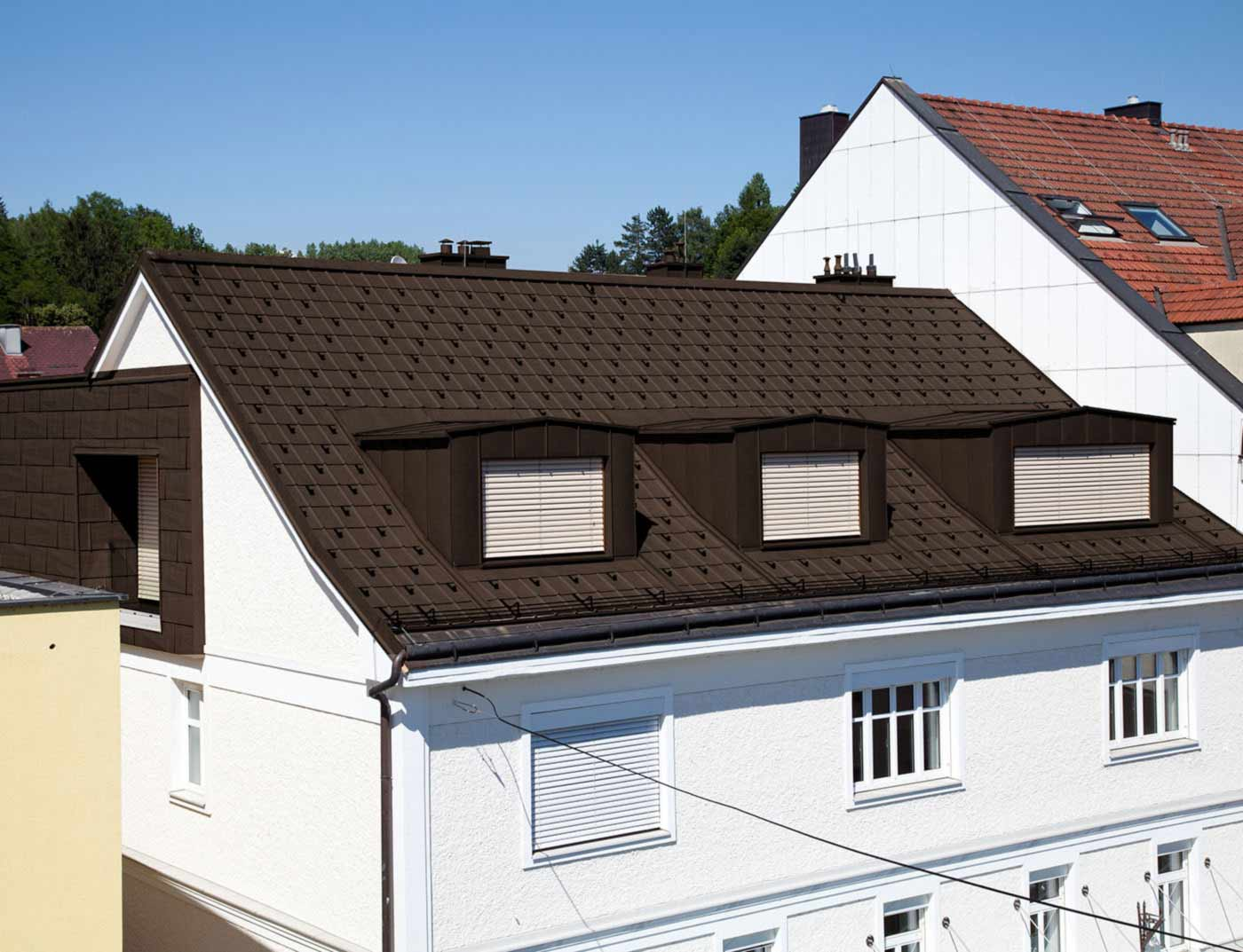 Reference buildings PREFA Roof systems Roof tile 11 nut brown (own colour)
