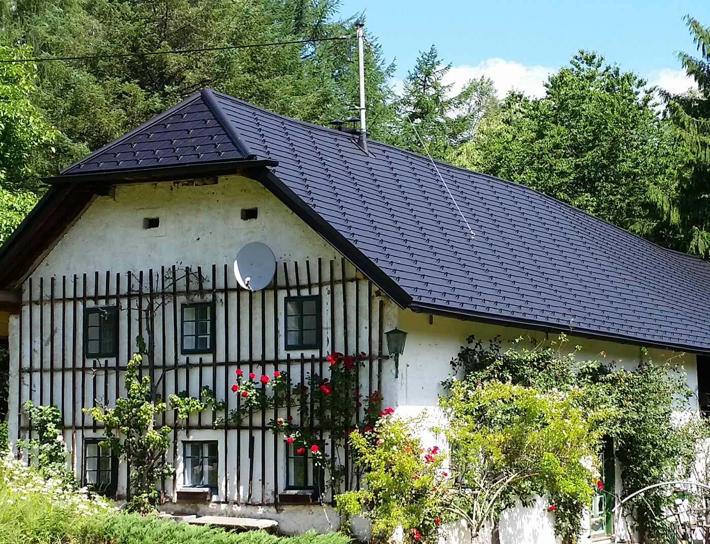 Reference buildings PREFA Roof systems Shingle 03 black (own colour)