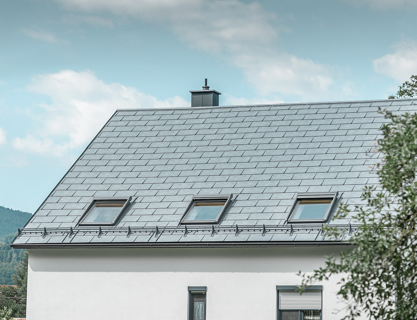 Reference buildings PREFA Roof systems R.16 roof tile 43 stone grey (own colour)
