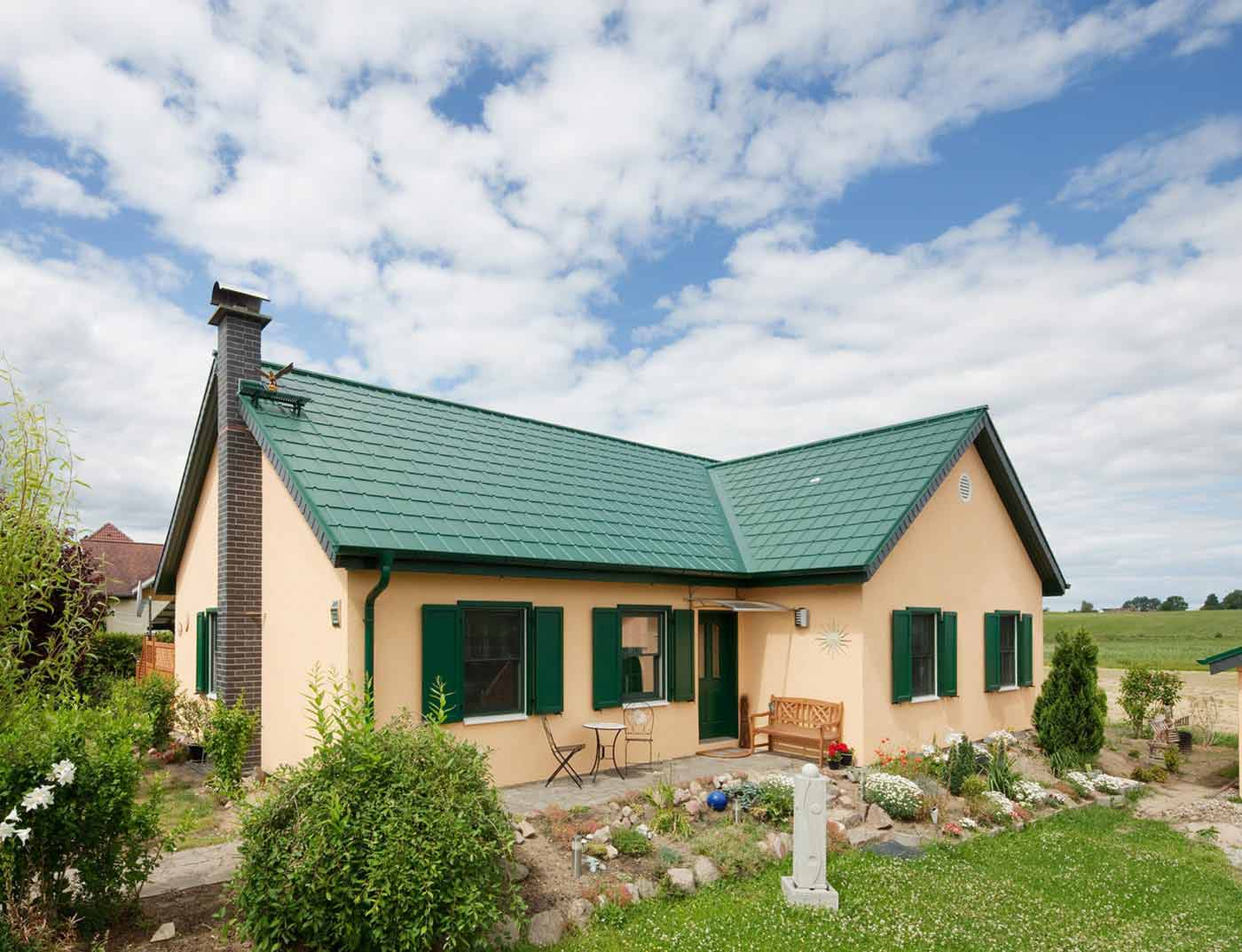 Reference buildings PREFA Roof systems Roof tile 06 moss green (similar to RAL 6005)