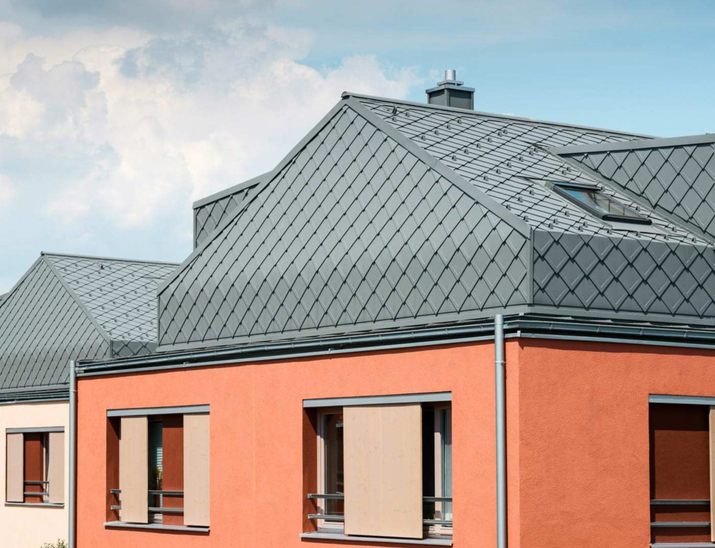 Reference buildings PREFA Roof systems Rhomboid roof tile 29 × 29 07 light grey (similar to RAL 7005)