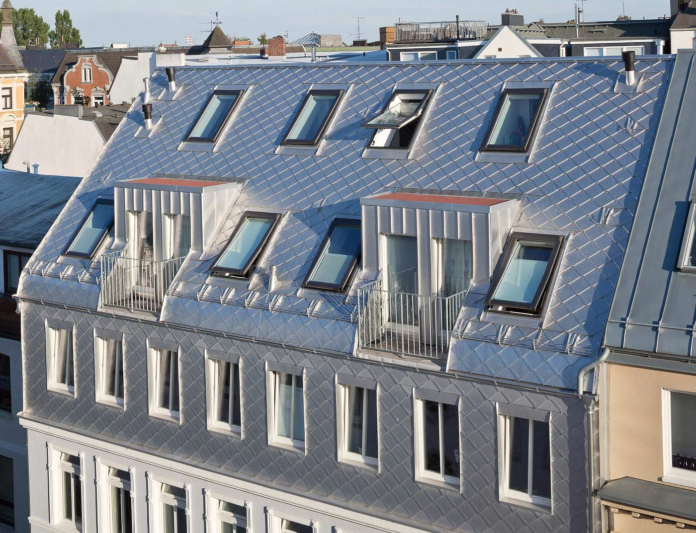 Reference buildings PREFA Roof systems Rhomboid roof tile 29 × 29 13 plain aluminium