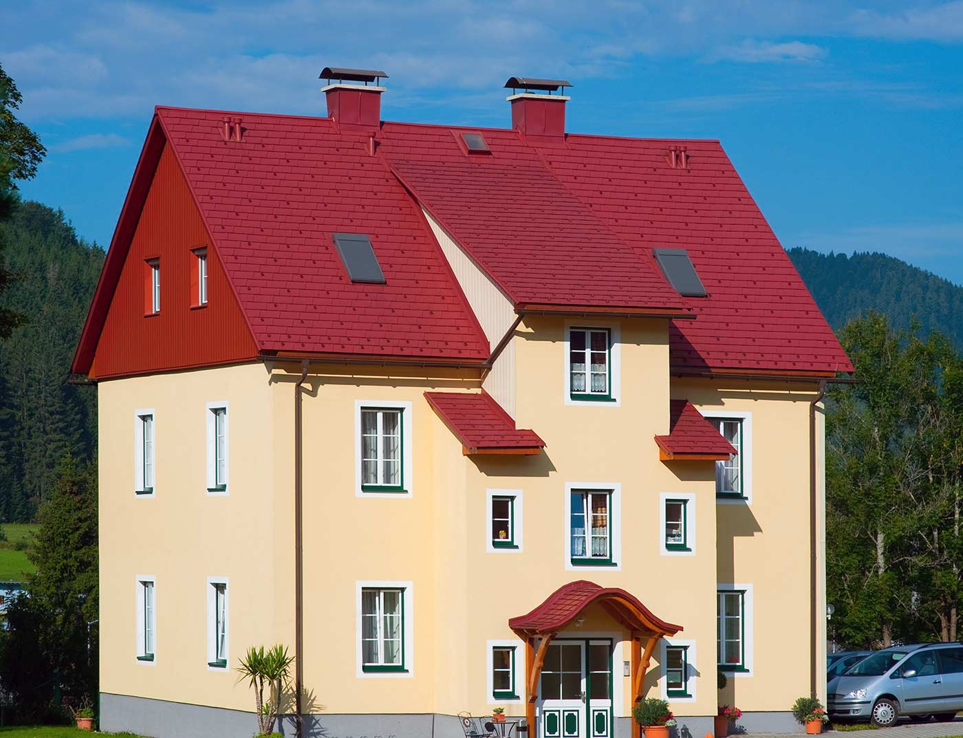 Reference buildings PREFA Roof systems Shingle 05 oxide red (similar to RAL 3009)
