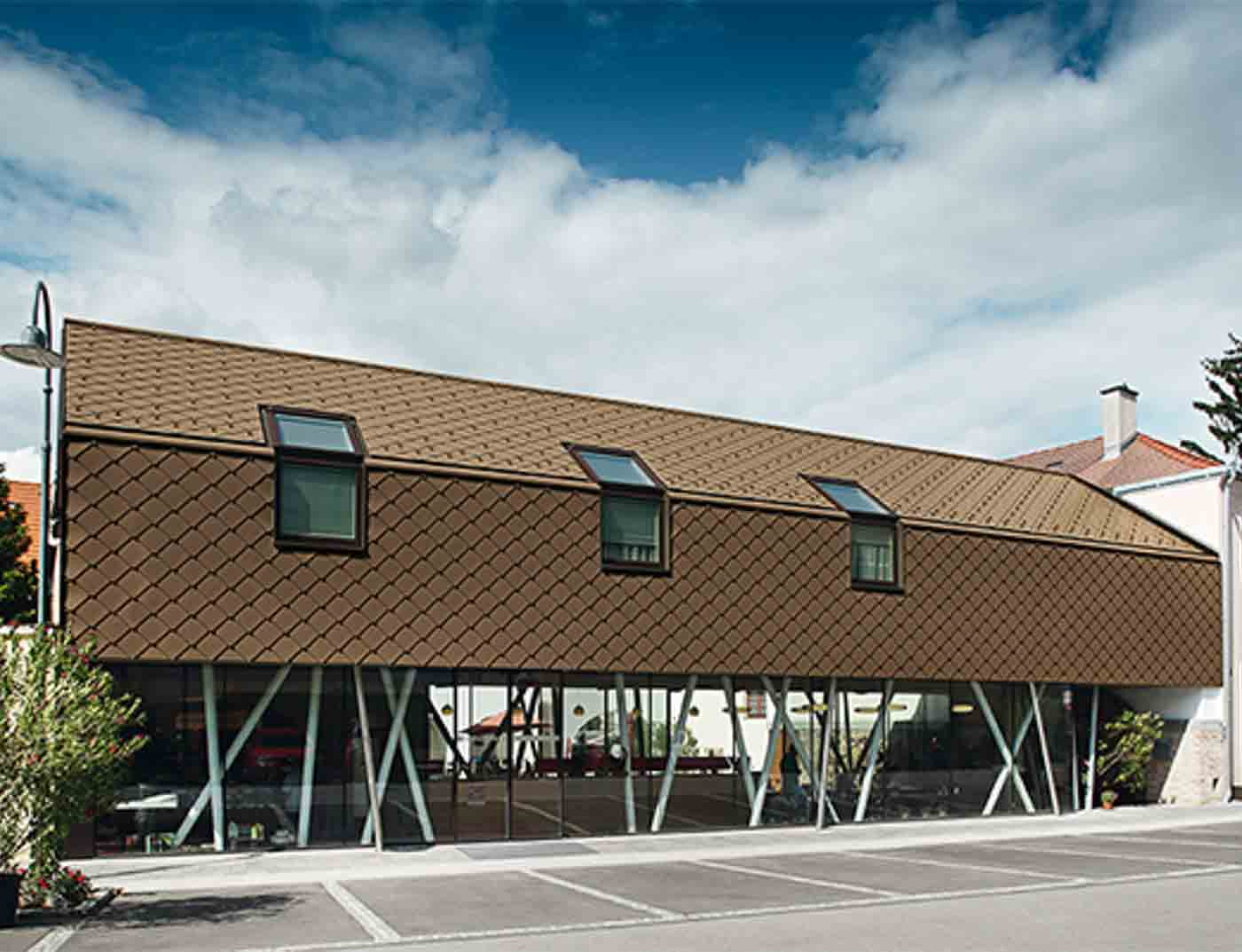 Reference buildings PREFA Façade systems Rhomboid façade tile 29 × 29 01 brown (own colour)