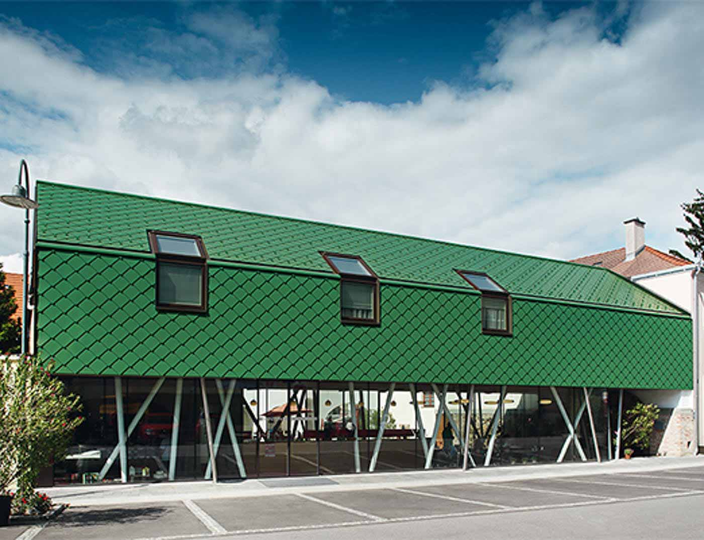 Reference buildings PREFA Façade systems Rhomboid façade tile 29 × 29 06 moss green (similar to RAL 6005)