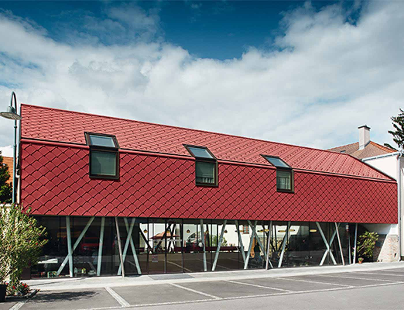 Reference buildings PREFA Façade systems Rhomboid façade tile 29 × 29 05 oxide red (similar to RAL 3009)