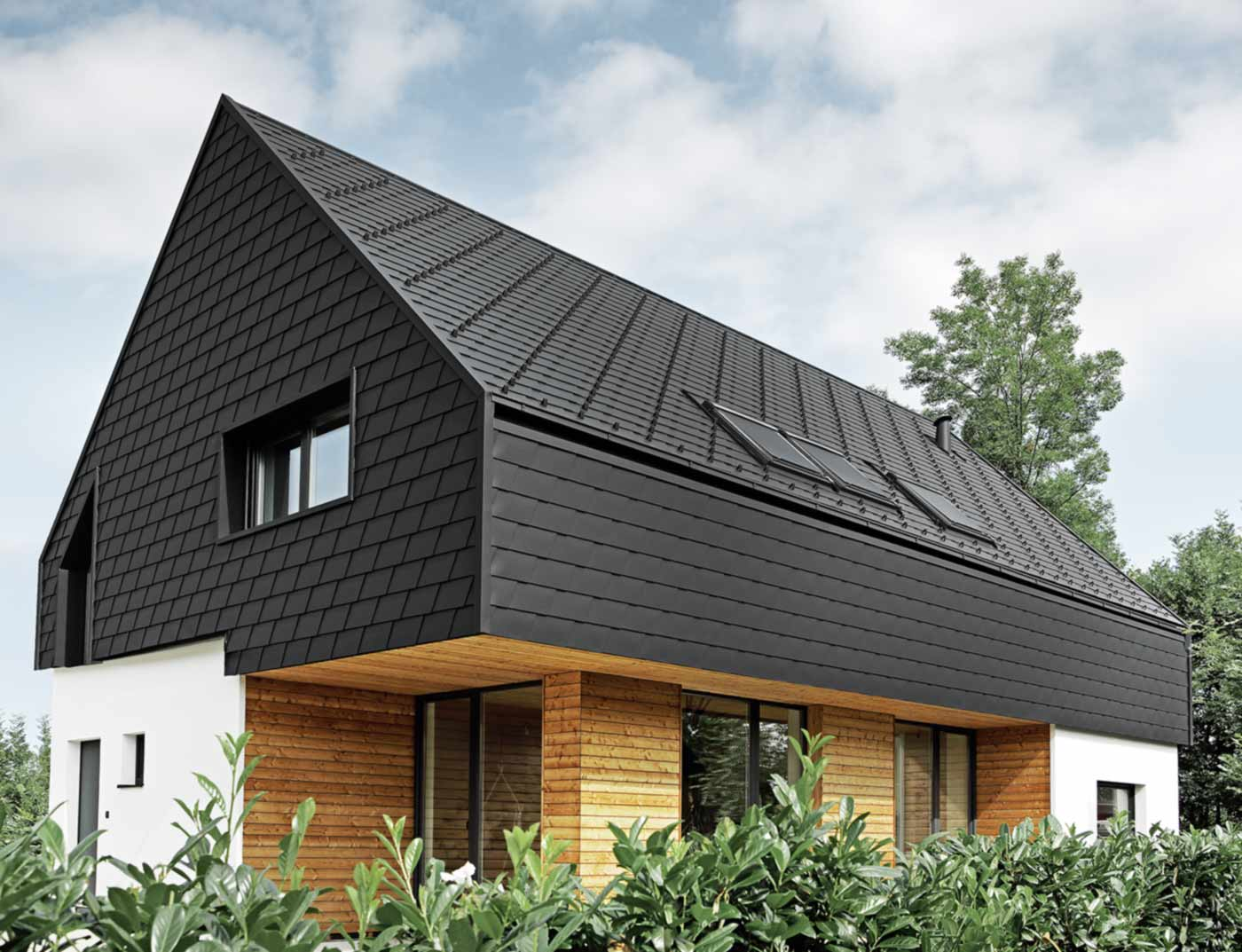 Reference buildings PREFA Façade systems Façade shingle 03 black (own colour)